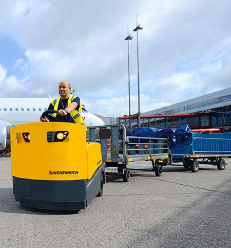 Driving an airport tow-tractor with trailer